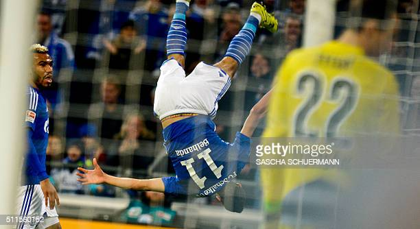 Schalke's Schalke's midfielder Younes Belhanda celebrates scoring the 10 goal with his teammates during the German first division Bundesliga football...