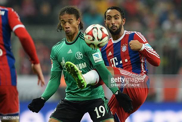 Schalke's striker Leroy Sane and Bayern Munich's Moroccan striker Medhi Benatia vie for the ball during the German first division Bundesliga football...