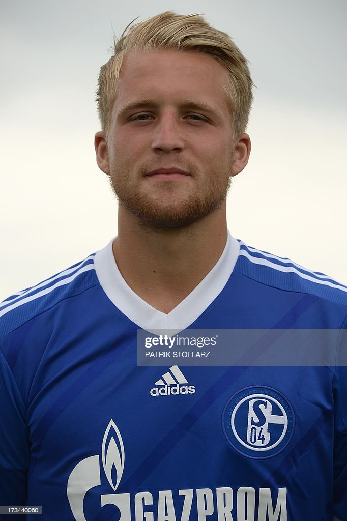 Schalke's striker Philipp Hofmann poses during a team photo call of German first division Bundesliga football club Schalke 04, on July 10, 2013 at the grounds of the former coal mine 'Consolidation' in Gelsenkirchen, western Germany.
