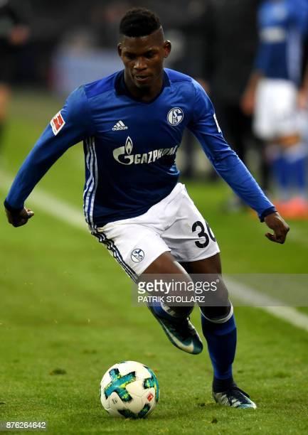 Schalke's Swiss midfielder Breel Embolo runs with the ball during the German First division Bundesliga football match between Schalke 04 and Hamburg...