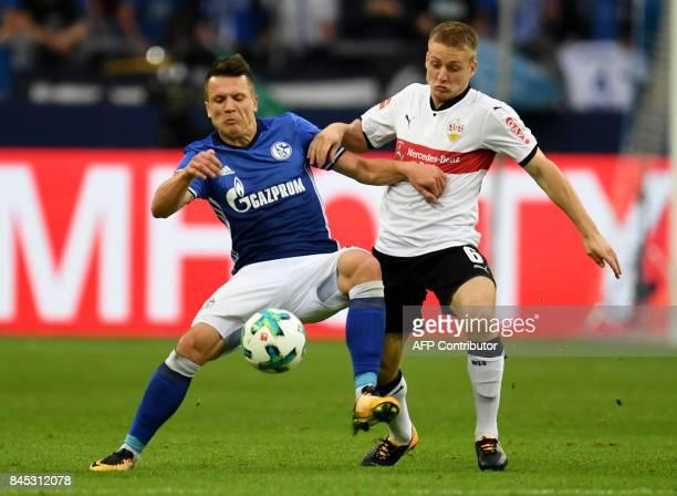 Schalke's Ukrainian midfielder Yevhen Konoplyanka and Stuttgart´s Argentinian midfielder Santiago Ascacibar vie for the ball during the German First...