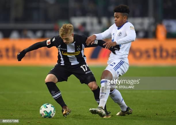 Schalke's US midfielder Weston McKennie and Moenchengladbach's Swedish defender Oscar Wendt vie for the ball during the German first division...