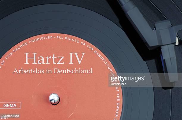 Schallplatte mit der Aufschrift Hartz IV Arbeitslos in Deutschland