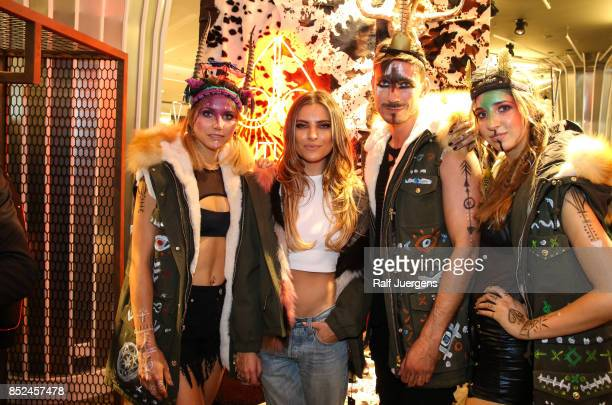 Schamans and Sophia Thomalla pose during the store event 'Moose Knuckles at Breuninger The Future Tribe Party' on September 23 2017 in Duesseldorf...