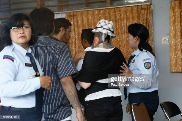 Schapelle Corby with her face covered reports for a parole hearing before being released on February 10 2014 in Denpasar Bali Indonesia Australian...