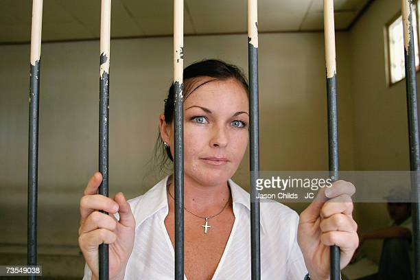 Schappelle Corby stands behind the bars in the holding cell at Denpasar District Court August 25 2006 in Denpasar Bali Indonesia Corby's defence team...
