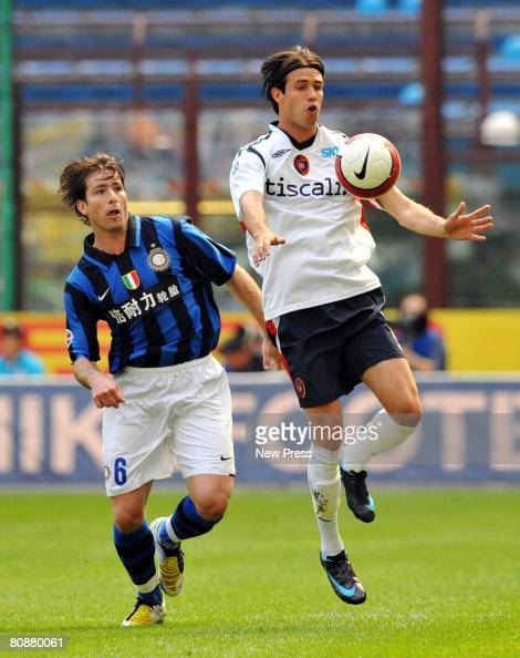 Scherrer Cabelino Maxwell of Inter and Robert Acquafresca of Cagliari in action during the Serie A match between Inter and Cagliari at the Stadio...