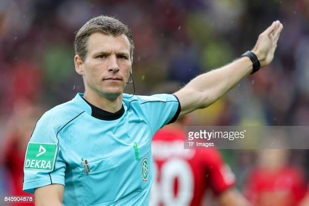 Schiedsrichter Benjamin Cortus gestures during the Bundesliga match between SportClub Freiburg and Borussia Dortmund at SchwarzwaldStadion on...