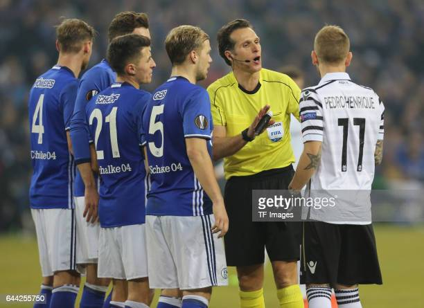 Schiedsrichter Luca Banti speak with Pedro Henrique of PAOK during the UEFA Europa League Round of 32 second leg match between FC Schalke 04 and PAOK...