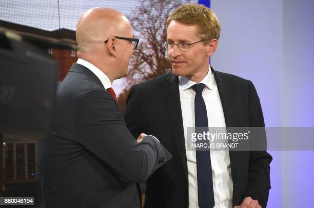 SchleswigHolstein State Premier Torsten Albig shakes hands with Daniel Guenther candidate of the Conservative Christian Democrats party for the...
