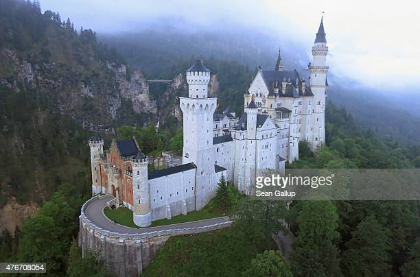 Schloss Neuschwanstein castle stands in this aerial view in the early morning on June 11 2015 near Hohenschwangau Germany Schloss Neuschwanstein...