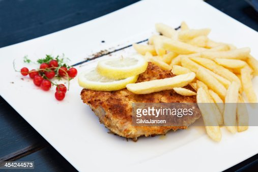 Schnitzel and french fries : Stock Photo