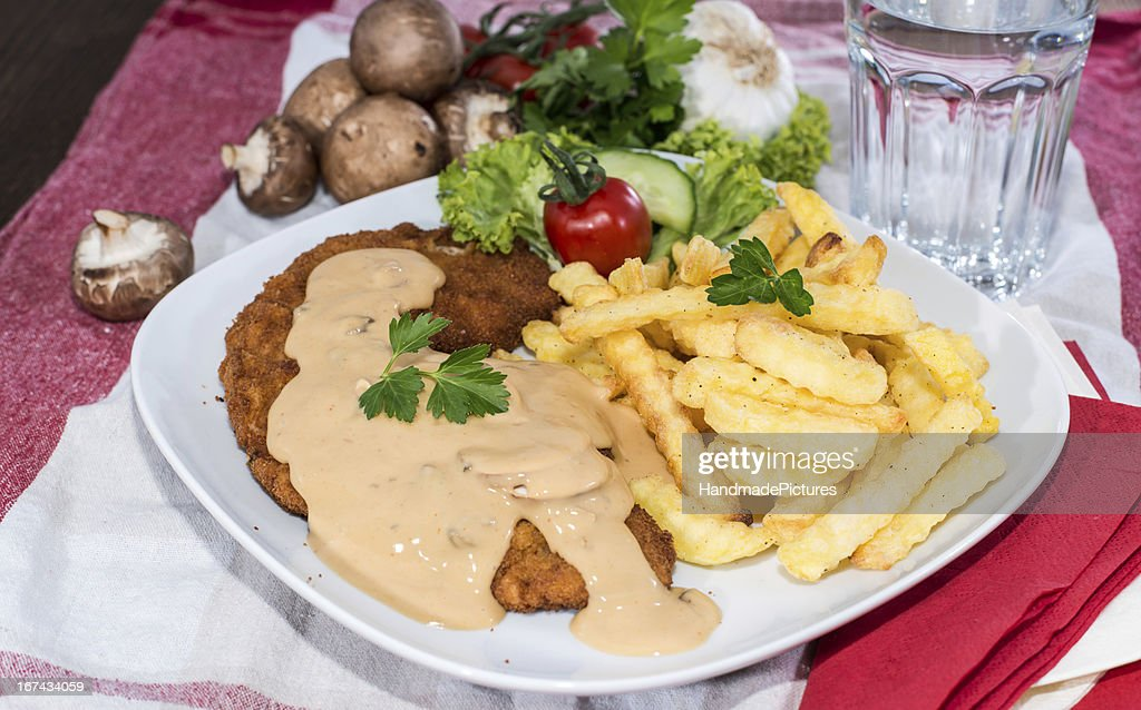 Schnitzel with Chips and Sauce : Stock Photo