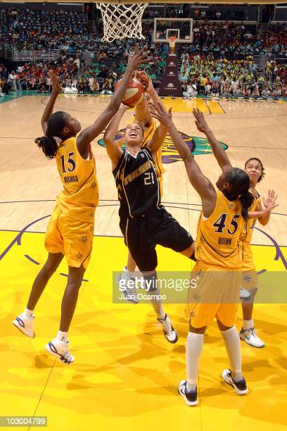 Scholanda Robinson of the Tulsa Shock goes to the basket against Chanel Mokango and Noelle Quinn of the Los Angeles Sparks on July 20 2010 at Staples...