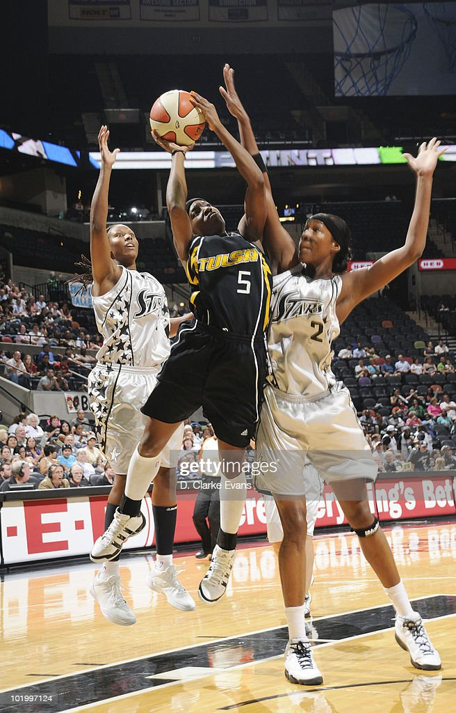 Scholanda Robinson of the Tulsa Shock shoots against Chamique Holdsclaw and Michelle Snow of the San Antonio Silver Stars on June 11 2010 at the ATT...