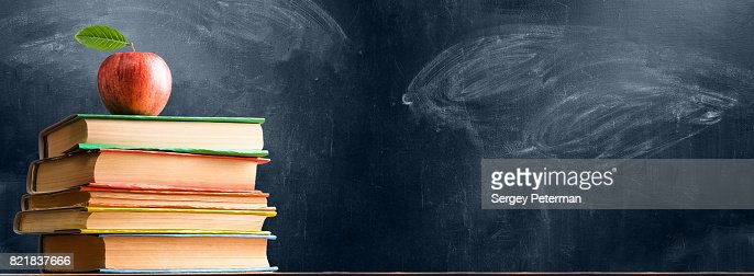 School accessories against blackboard : Stock Photo