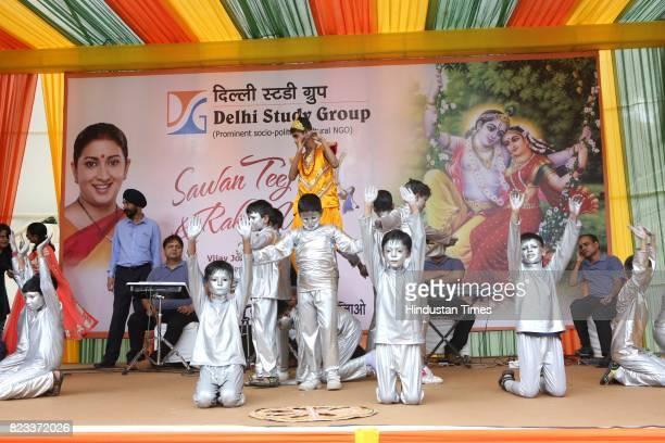 School and NGO children perform during the Teej festival celebrations organised at the residence of Union Minster Smriti Irani on July 25 2017 in New...