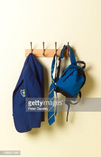 School blazer and bag on coat rack