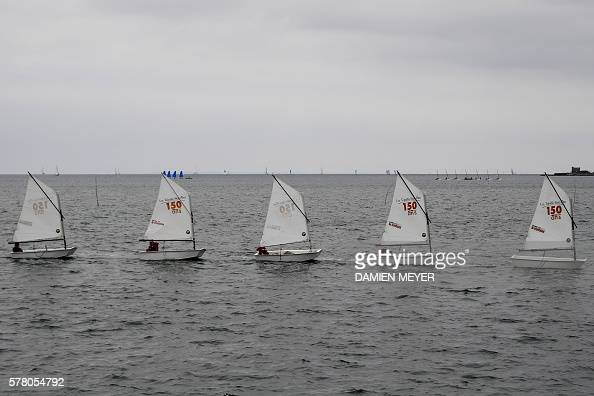 School boats sail in Gulf of Morbihan on July 20 2016 off the coast of La TrinitesurMer / AFP / DAMIEN MEYER