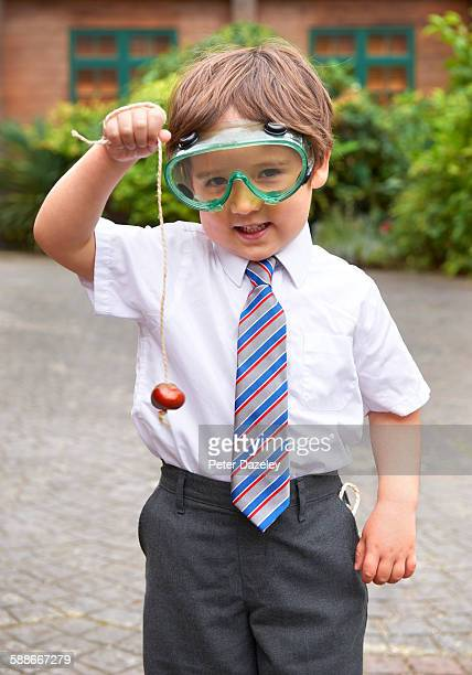 School boy playing conkers