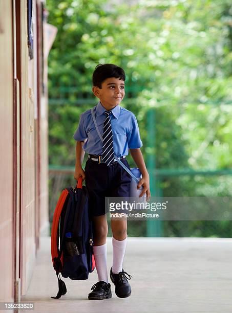 School boy with a school bag