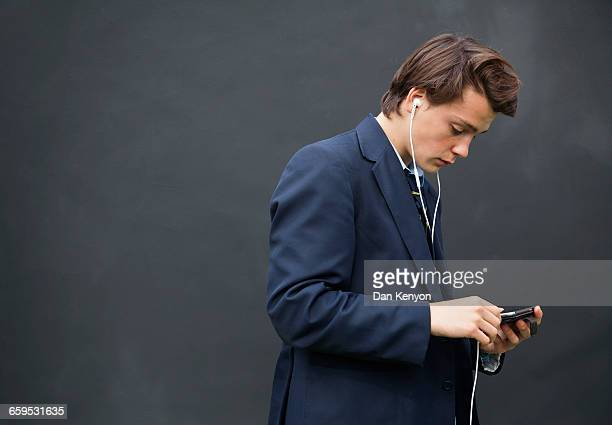 School boy with headphones  and mobile device