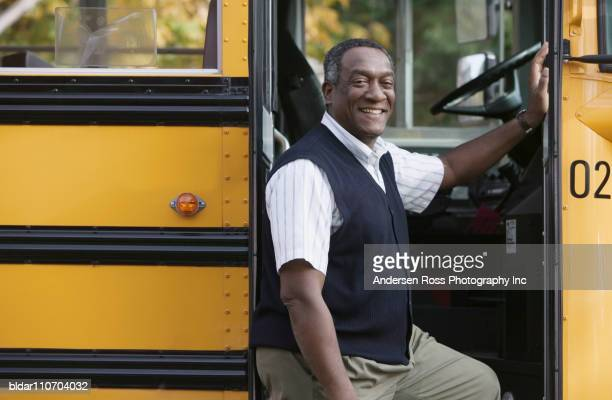 School Bus Driver Standing by Bus
