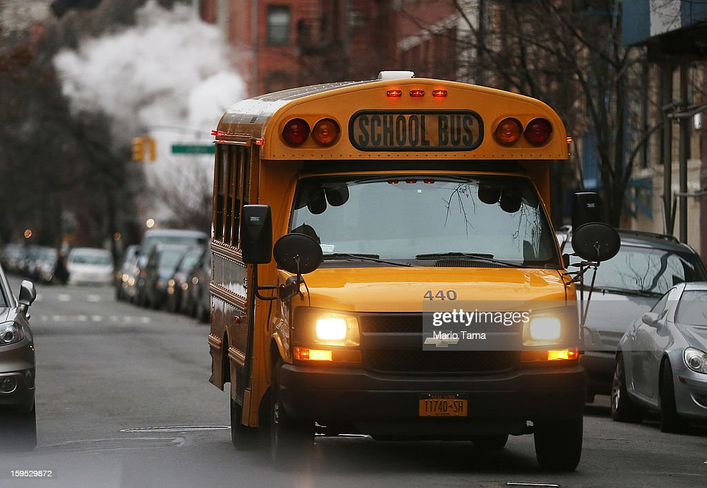 A school bus drives down a street in Manhattan's East Village on January 15 2013 in New York City Drivers of the city's school buses are set to go on...