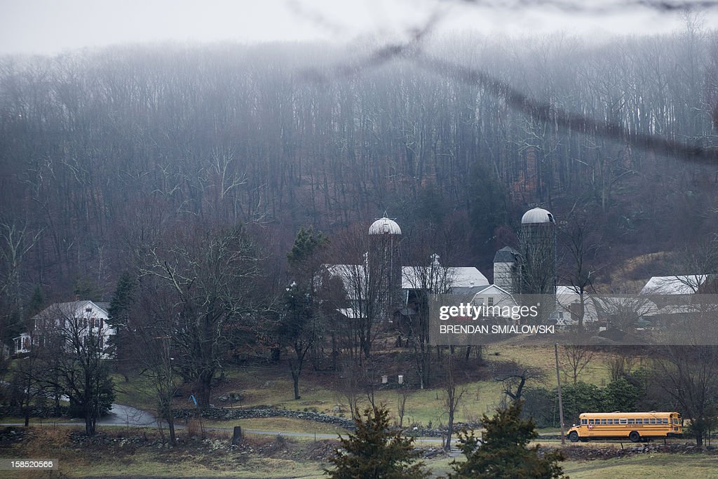 A school bus drives past a farm while picking up students December 18, 2012 in Newtown, Connecticut. Students in Newtown, excluding Sandy Hook Elementary School, return to school for the first time since last Friday's shooting at Sandy Hook which took the live of 20 students and 6 adults. AFP PHOTO/Brendan SMIALOWSKI