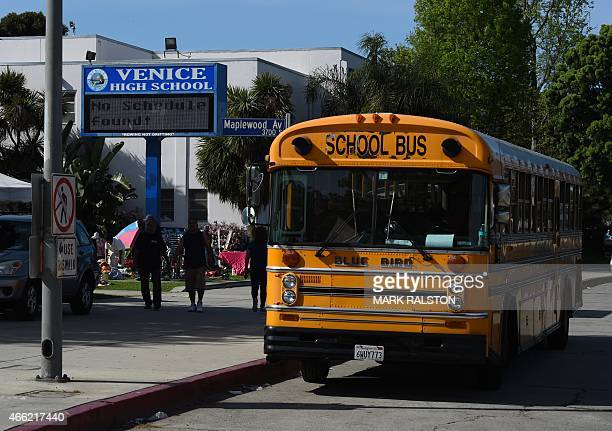 A school bus is parked outside the Venice High School where police are investigating allegations of the sexual assault of students at the school in...
