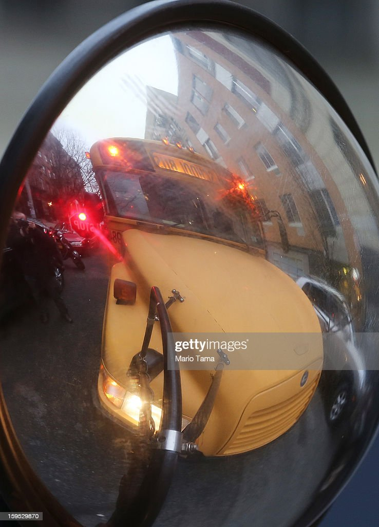 A school bus is reflected in a mirror while making a stop in Manhattan's East Village on January 15, 2013 in New York City. Drivers of the city's school buses are set to go on strike tomorrow after negotiations with Mayor Michael Bloomberg failed to reach an agreement; over 150,000 children will need to find an alternate method of transportation to school.