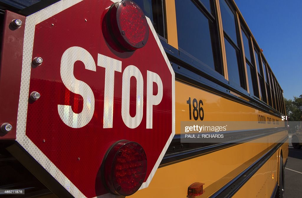 A school bus is seen during a safety event for children at Trailside Middle School in Ashburn Virginia on August 25 2015 AFP PHOTO/PAUL J RICHARDS