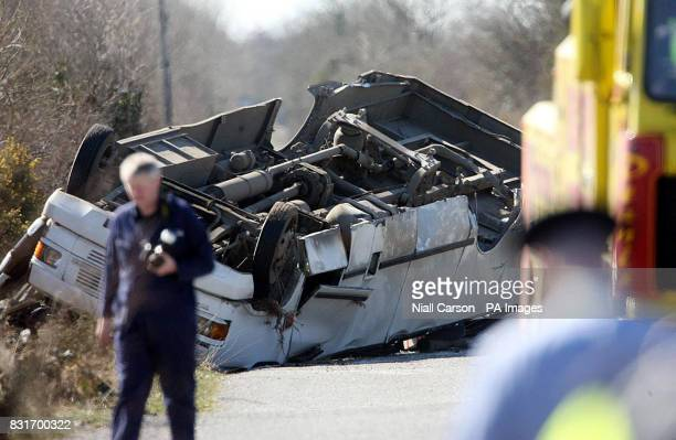 A school bus lies on its roof after an accident in the Irish Midlands which left a 15yearold boy dead and at least 10 other students injured Tuesday...