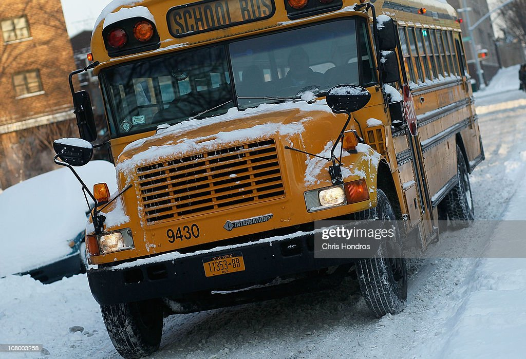 A school bus makes its way down a snowy road in a Brooklyn neighborhood following a storm January 12 2011 in New York City A winter storm again...