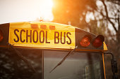 School bus close up at sunset