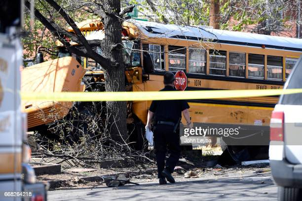 A school bus rest up against a tree after it was hit head on by a Jeep Grand Cherokee at 39th Tejon on April 13 2017 There were 5 school kids taken...