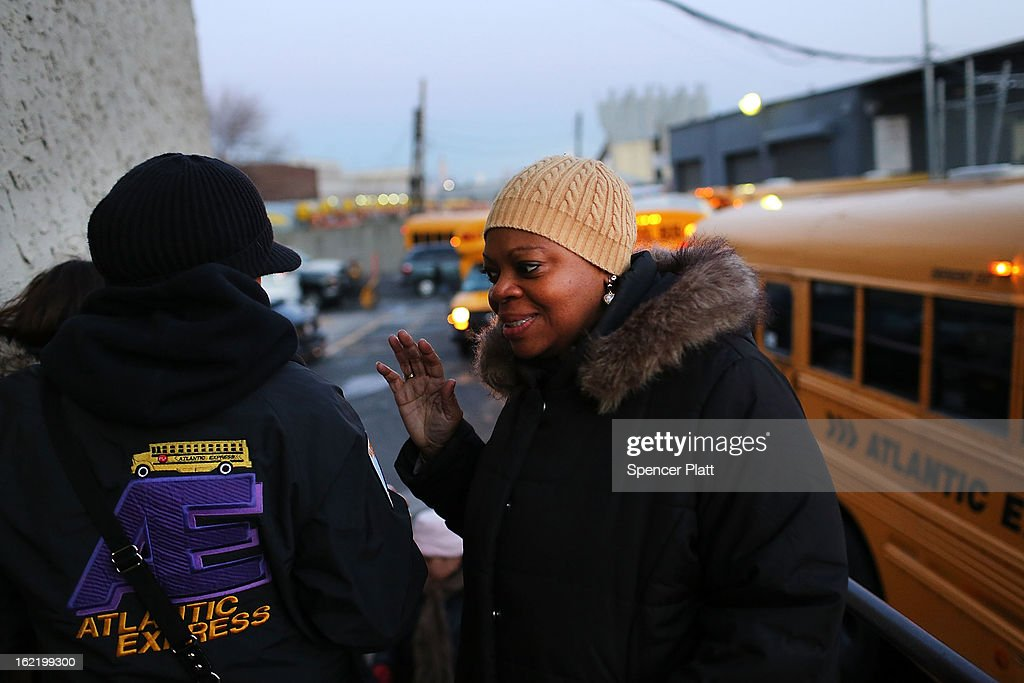 School buses and drivers at the Atlantic Express Transportation Crop. in Queens head back to work after the drivers and matrons suspended their January 16th strike on February 20, 2013 in New York City. Bus drivers and matrons, who are represented by the Amalgamated Transit Union Local 1181, serve more than 150,000 children, many of them with disabilities. After a one month strike and no concessions from the Bloomberg administration, workers decided to wait to bargain with prospective New York City mayoral candidates after this year's election.