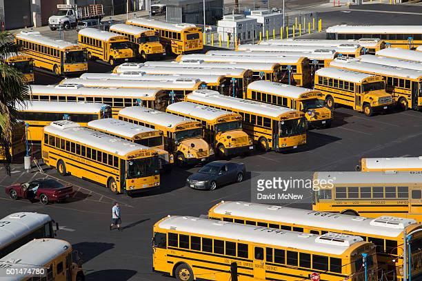 School buses stand idle as all Los Angeles city schools are shut down in reaction to a threat on December 15 2015 in Los Angeles California A bomb...