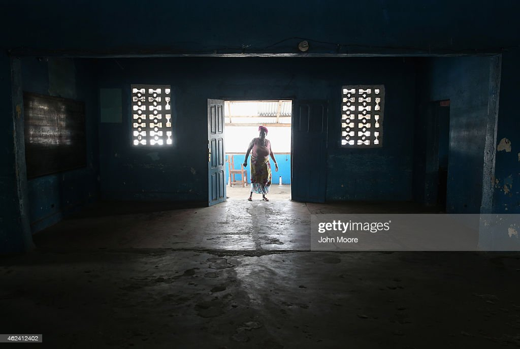 A school caretaker walks into a kindergarden on January 27 2015 in Monrovia Liberia Although Liberian schools are scheduled to reopen next Monday...