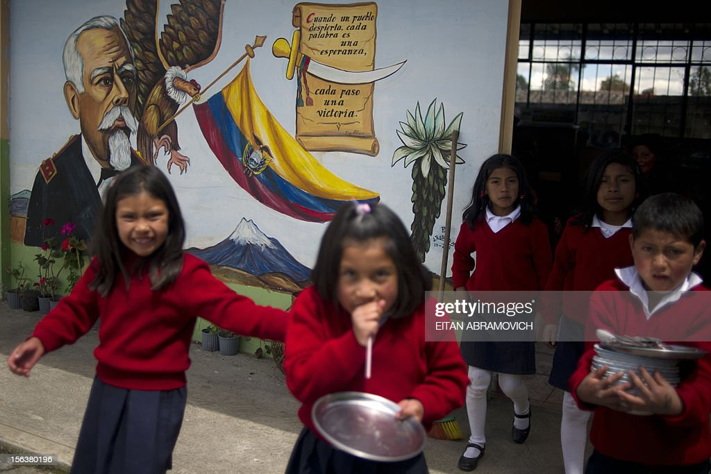 School children are pictured at a rural school with a significant number of Colombian refugees at La Palizada in Tulcan, Carchi province, close to the Colombian border on November 7, 2012. AFP PHOTO/Eitan Abramovich