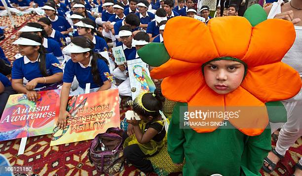 School children assemble prior to participating in the Autism Awareness Walk 2013 at India Gate in New Delhi on April 9 2013 Autism is a...