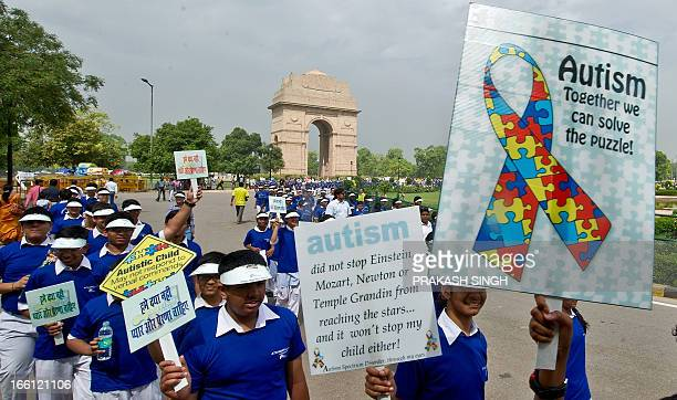 School children carry placards as they participate in the Autism Awareness Walk 2013 at India Gate in New Delhi on April 9 2013 Autism is a...