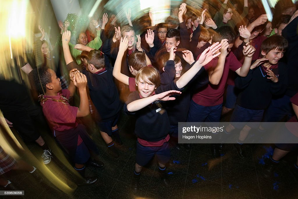 School children dance with Brazilian percussion and dance group Batucada during Paralympics New Zealand's '100 Days To Go' event at Te Papa Museum on May 30, 2016 in Wellington, New Zealand.