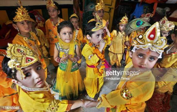 School children dressed as Hindu god Lord Krishna pose during Janmashtmi celebrations at a school on August 27 2013 in New Delhi India Janmashtami is...
