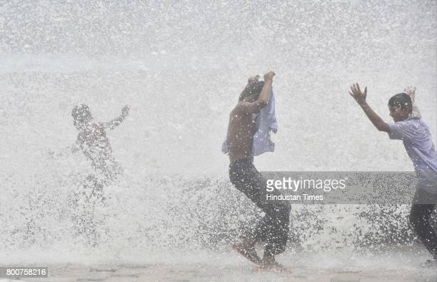 School Children enjoy the high tide at Worli Sea face on June 24 2017 in Mumbai India Mumbai witnessed high tide with a maximum height of 502 metres...