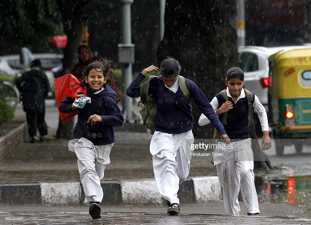 School children enjoying the rainfall on February 23, 2013 in New Delhi, India.