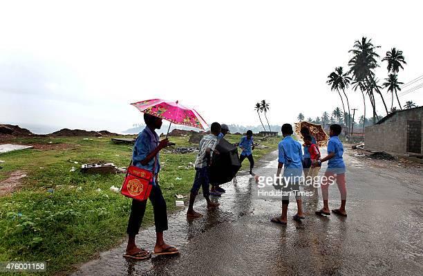 School children enjoys the arrival of Monsoon as Kerala witnessed monsoon rains on Friday in Kovalam India on June 05 2015 School reopening in Kerala...