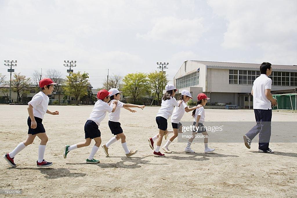 School children following teacher