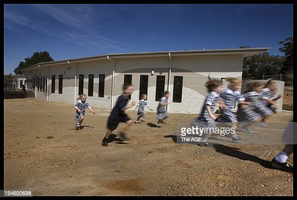 School children from Emmaus Catholic primary School at Mt Clear near Ballarat make a run for home on the last day of school for the term In the...