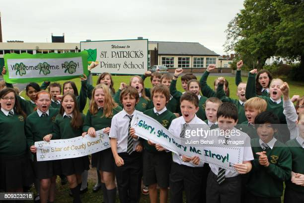 School Children from Rory McIlroy's old school St Patrick's Primary School Hollywood CoDown celebrate outside the school gates as he travels home...